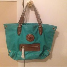 large Tote Brand new, inspired. excellent condition. Never used. Turquoise and brown with gold hardware. Long shoulder strap included. Price is negotiable and, I will consider all reasonable offers! Bags Totes