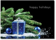Happy holiday Christmas cards feature pine branch and blue ornaments on the front. Inside choice of verse and personalized with family or business name.