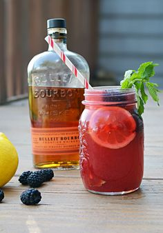 Blackberry Bourbon Lemonade: 2 ounces bourbon 2 ounces lemon juice 1 ounce blackberry puree, strained* 1 ounce simple syrup Dash of aromatic bitters Dash of sparkling wine Mint, to garnish Blackberries, to garnish Lemon slices, to garnish