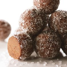 Served chilled, these balls are formed when a batch of brownies is broken into bits, flavored with dark rum, and rolled.