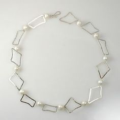 N42- Jenni K Jewelry- Jennik.com  This necklace features 12 Pearls and 12 hammered Sterling Silver rectangles.
