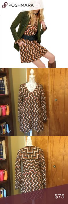 Free People Rhiannon chevron knit dress A wonderful warm knit chevron sweater by free People. The sleeves are bell shaped and feature zipper details. Pair this with a belt and brown boots for a cute boho look! The material is a wool/acrylic blend Free People Dresses Mini