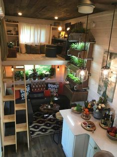 Office Loft & Living Room - Ever Growing Tiny House The 330 sq. Ever Growing Tiny House features a custom wall garden with three planter boxes, an office loft, and a multifunction music room/guest bedroom. Tyni House, Tiny House Loft, Best Tiny House, Tiny House Living, Tiny House Plans, Tiny House Design, Tiny House On Wheels, Inside Tiny Houses, Tiny Loft
