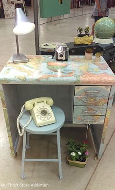 Wonderful upcycled map desk and repurposed camera lamp crafted by King's Whimsy: mythriftstoreaddiction.blogspot.com