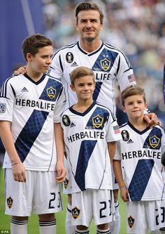 Family support: The sportsman was joined by Brooklyn, Romeo and Cruz during the MLS Cup Final at the Home Depot Center on Saturday 12/1/12.