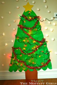 Make your own paper Christmas tree - would make a great collaborative art project, AND a vertical surface opportunity!