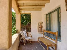 Classic Eastside Santa Fe! This fantastic adobe has been completely updated and features diamond plaster walls, two wood burning kiva fireplaces, hard...