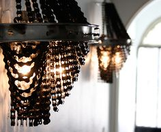 chandaliers made from recycled bike parts!!! i want one for my room!