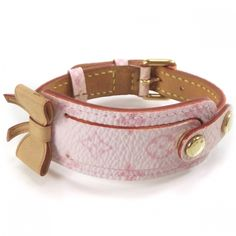 Louis Vuitton Pink Cherry Blossom Wish Bracelet.  The bracelet is made of both pink monogram toile canvas and vachetta cowhide leather.