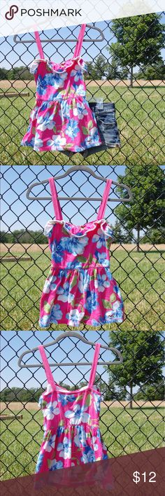 Hollister Floral Tank Top ITEM- Hollister Fashion Tank CONDITION- Good. Some piling and a bit faded. Overall, very nice condition. STYLE- Floral Fashion Tee COLOR- Multicolor SIZE- Small FIT- True to size. Hollister Tops Tank Tops
