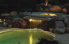 Great use of lighting for a waterfall using Hadco products  #landscapelighting