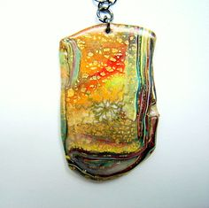polymer clay, gold leaf--detailed in gold ink. Could be reversible.