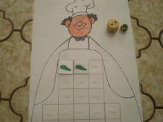 Spel: Het schort van de bakker. Ieder kind heeft een bakkersschort. Om de beurt met de dobbelstenen gooien. Het goede aantal broodjes in de juiste kleur op het schort plaatsen. De winnaar is degene die het eerste zijn schort vol heeft.