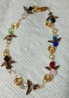 Dainty multi-hued angel bracelet with handcrafted links, 7.5 inches by rowdylady on Etsy