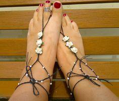White summery barefoots on plaited wax thread.