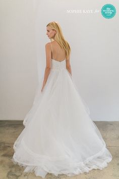 Christos gorgeous simple back design with a tulle skirt and thin straps // We're still dreaming of these refreshing New York Bridal Fashion Week finds from Alexandra Grecco, CHRISTOS BRIDAL, Leanne Marshall and Limor Rosen Bridal Couture! Like your favs, Wedding Scoopers! // : Sophie Kaye Photography for The Wedding Scoop