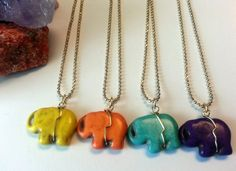 Gold plated chain with a colorful mini elephant by ElephyTreasures, $20.00 This gold chain is 17.5 inches long. It is 10K gold plated allowing it to be a longer lasting piece. It has a mini elephant handcrafted using mixed howlite stones. This stone is believed to be a super-calming stone. It is often used to relieve stress or to absorb your own anger or another's anger that is directed toward you, therefore adding to your own protection of energy.