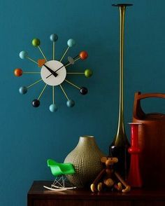 MLF® Nelson Ball Clock was designed by George Nelson in 1948 and is widely considered to be one of his most beloved design creations. Multi-Color. Wooden Balls & Aluminum Quartz Holder.