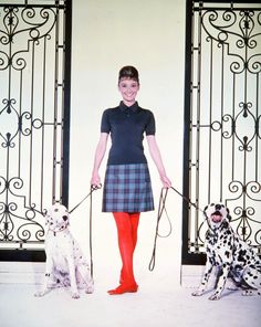 Audrey Hepburn w/ dalmations - photographed by Bud Fraker for her publicity photos. New York; March 1961. Polo: Lacoste. Skirt: Hermès Flats: Céline.