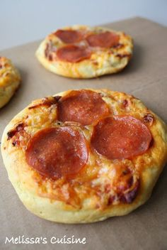 Pizza Sliders made with Grands biscuits!  (I have been making these for years and years for my kids. I make my own sauce, bake and then wrap in plastic wrap and kids would LOVE these camping or at the beach. I could eat several in one sitting too....)