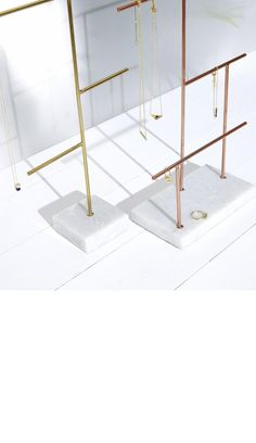 Combining a sleek and weighty marble base with structural metallic lines, our minimalist Large Copper & Marble Jewellery Stand allows your jewellery to make the statement.