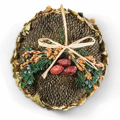 Sunflower Seed Head Wreaths -- a natural and artistic way to feed the birds.  This would be a great hostess gift this fall.