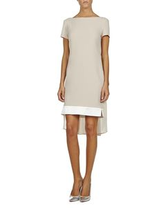 This beige and white crepe dress is exceptionally flattering thanks to its loose-shape and effortless  draped back. Style this elegant piece with sandals and a box clutch.