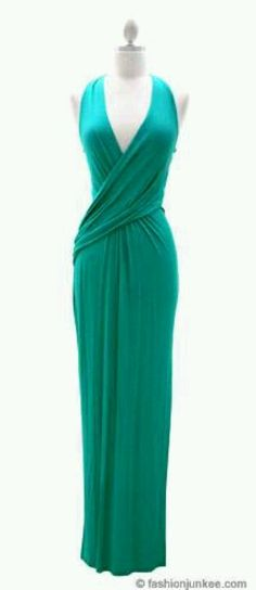 "Jersey Low Cut Plunging Neckline Long Maxi Dress-Blue Green ITEM ID: LONG PLUNGE DR-JD Long maxi dress. Soft jersey fabric. Low cut neck line. Neckline plunges into a low cut v-neckline. Fabric crosses over at the waist for an elegant touch. Ties at the back of the neck for a perfect fit. Slit at the side measures about 24"" high. Simply sexy and stunning"