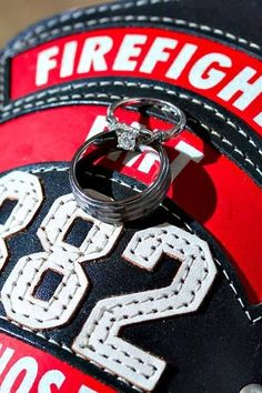 The groom from a recent wedding at Tapestry House was firefighter, so they took this photo to show off the rings and his firefighter gear! So pretty! Photo by Tom K. Photography