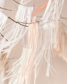 DIY skinny fringe garland on branches using tissue paper #diyidea