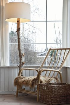A natural wood lamp and simple furniture give a rustic yet spacious look to a Danish beach cottage