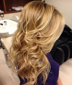 Blonde Wavy Downdo With A Bouffant