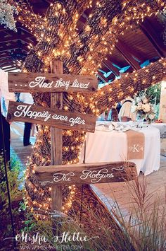 Hand painted wooden signs at wedding reception; could be modified for just about any out-of-doors special occasion.