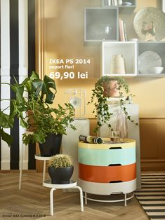 A plant stand, a side table, pedestals, and wall cabinets display decorative items and plants. Ikea Ps 2014, Create Your Own Canvas, Orange Rooms, Free Standing Wall, Home And Living, Living Room, New Home Designs, Beverly Hills, Furniture Decor