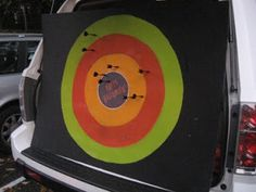 Trunk or Treat idea - dart board  Different candy given depending on which part of target you hit.  Interactive fun!