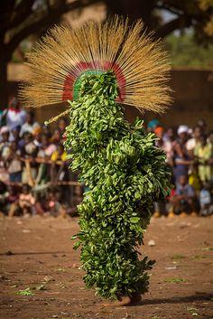 Festival des Masques de Dédougou, Burkina Faso The festival of masks in Burkina Faso including masks, leaves, fiber masks, feather masks, white masks, masks with straw masks skins