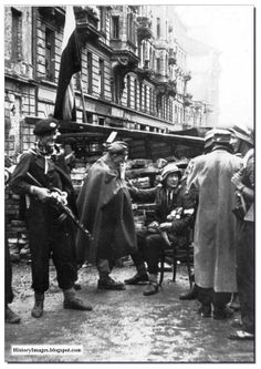 Warsaw insurgents put up a barricade on a Warsaw street. September 1944