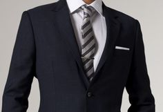 The asymmetrical tie knot on this look puts it over the top. I think it's a four-in-hand? So good