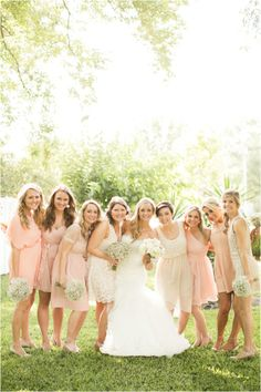 Bridesmaid's wearing coral and beige, lace dresses ~ Photo: Mustard Seed Photography