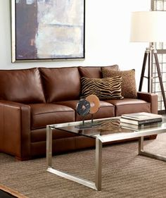 A leather sofa looks modern & lighter with silver finishes = Ethan Allen