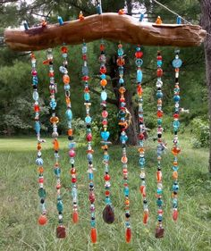 Luxurious Custom Made-to-order Bohemian Beaded Sun Catcher Driftwood Wall Hanging Curtain Suncatcher. Item shown I made as a gift for my best friend/long-distance boyfriend, and each strand is adorned with personal touches like charms that represent what he loves, inside jokes, and sentimental Beaded Door Curtains, Hanging Curtains, Crystal Curtains, Bead Crafts, Diy Crafts, Door Beads, Diy Wind Chimes, Hanging Crystals, Sun Catcher