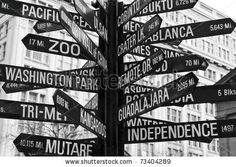 stock photo : A sign of different locations in Pioneer Square, Portland, Oregon