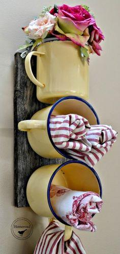 Repurposed Kitchen Tools via KnickofTime.net - enamel mugs on barn wood for simple storage, vase
