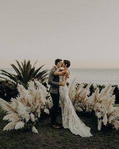 dreamy oceanside wedding-wedding ceremony-pampas grass plumes-coastal wedding-coastal bride-boho bride-boho wedding-bride and groom-first kiss wedding-beach wedding-beach bride-ceremony altar-beach ceremony-first kiss- bohemian bride-bohemian wedding-lace Wedding Ceremony Ideas, Beach Ceremony, Beach Wedding Decorations, Wedding Photos, Ceremony Backdrop, Aisle Decorations, Wedding Altars, Wedding Ceremonies, Wedding Receptions