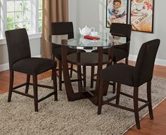 Daly Chocolate II Dining Room Collection | Furniture.com. With its combination of wood, metal and glass and a cool crossover base, the eye-catching round table shows that you're style savvy.