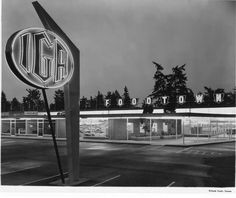 This was how the new IGA Foodtown store located at Park Avenue and Airport Way in Parkland appeared on the evening of August 16, 1955. One of the earliest strip malls in Pierce County, the complex contained the supermarket, bakery, variety store, cafe, beauty and barber shops, real estate office and dry cleaning plant.