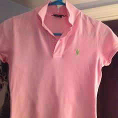 "Ralph Lauren pink ""Skinny Polo"" w green pony XS Authentic Ralph Lauren pink ""Skinny"" fit polo. Ladies slim XS, fits TTS but short in length. Pretty light pink color with green pony. I great condition, no tears, holes or stains. Pet and smoke free home! Ralph Lauren Tops"