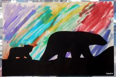 Tippytoe Crafts: Polar Animals. Night time picture. Use water colors to paint streaks for the Northern Lights. When dry, glue on black strip for snow & precut silhouettes of a momma polar bear and her cub.