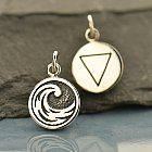 """This beautifully rendered, double sided charm features a drawing of curling ocean wave on one side and the symbol for """"water"""" on the other. The Water element symbolizes many things including dreaming, healing, fluidity, purification, regeneration, strength, change, fertility, devotion, and unconditional love. The element of Water is associated with Fall and its direction is West. The 4 Elements appear in many cultures such as ancient Egypt and Greece and in numerous religions including…"""