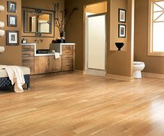 Hardwood or Laminate Wood Flooring (with radiant heating) - love the look of wood but hopefully laminate would be a more cost effective and durable option
